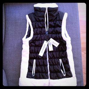 Black vest with faux fur trim
